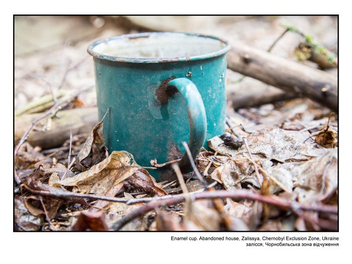 Enamel cup. Abandoned house, Zalissya, Chernobyl Exclusion Zone, Ukraine