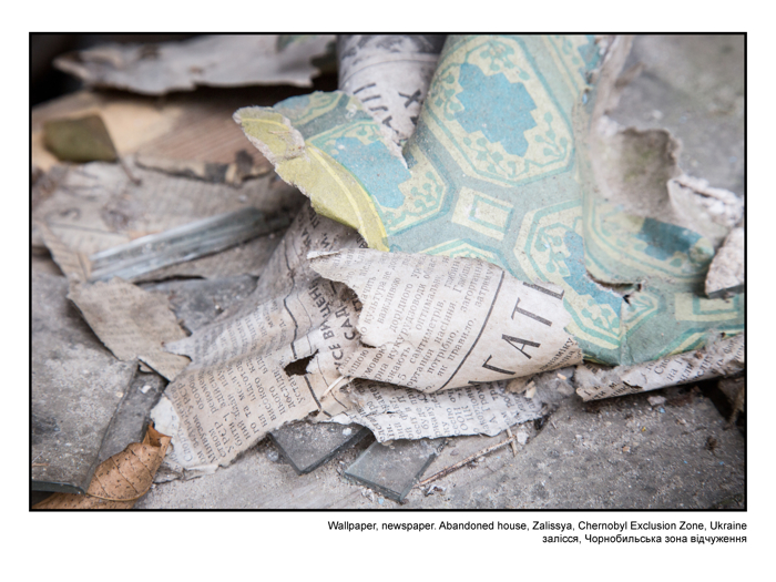 Wallpaper, newspaper. Abandoned house, Zalissya, Chernobyl Exclusion Zone, Ukraine